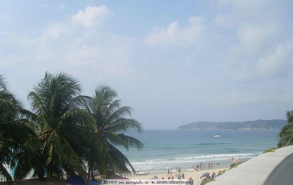 海南风景 蓝天 白云 远山 大海 游船 椰树 游人 沙滩 自然风景 自然